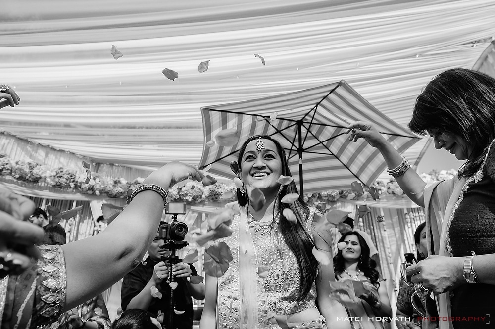 The future bride showered with rose petals by her family