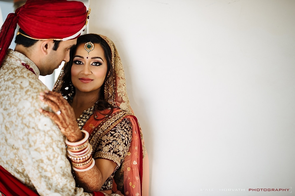 The indian bride and groom embrace