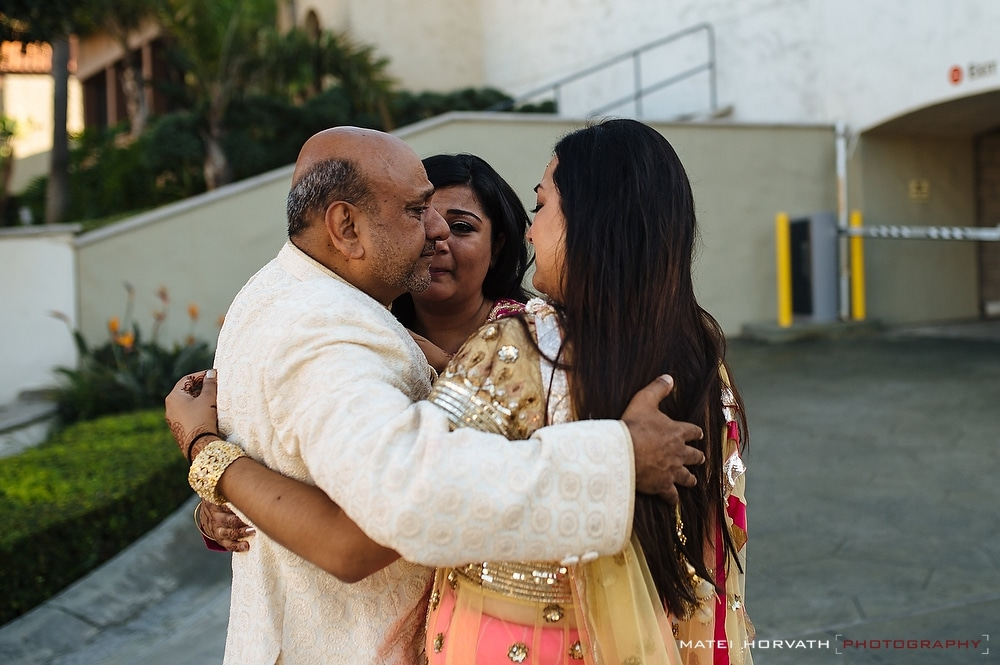the father is consoled by his daughters